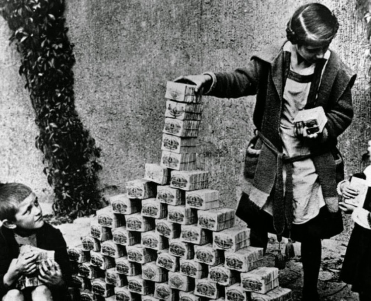 Children playing with stacks of hyperinflated currency during the Weimar Republic, 1922.jpg