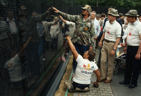 May 1986, Washington, DC, USA --- Double amputee Bob Wieland and other Vietnam veterans gather at the Vietnam Veterans Memorial, where Wieland was speaking about the economic plight of some in this country. Wieland somehow pushed himself across the country to get to Washington. --- Image by © Wally McNamee/CORBIS